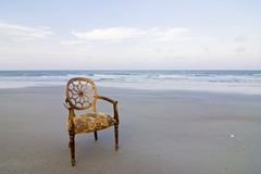 Ornate chair on beach Royalty Free Stock Photography