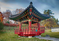 Ornate chinese pavilion in autumn park stock photography