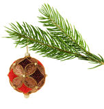 Ornate christmas ball hanging on a pine branch Royalty Free Stock Photo
