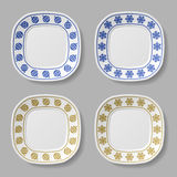 Ornate christmas ball snowflake plates Royalty Free Stock Image