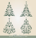 Ornate Christmas Trees. Set of beautiful ornamental Christmas Trees to create holiday cards, backgrounds and decoration Royalty Free Stock Image