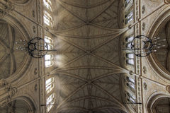 Ornate church ceiling. Light flowing through windows of an ornate church and carved ceiling Royalty Free Stock Photography