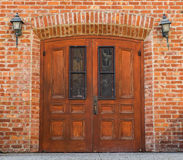 Ornate church door with brick building Stock Images