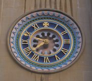 Ornate clock face. Ornate face of clock at Norwich cathedral, Norfolk royalty free stock image