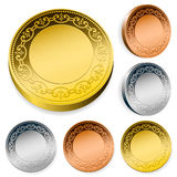 Ornate coin set in gold, silver and bronze Stock Image