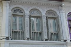 Ornate colonial windows and shutters purvis street 12 , Singapore Royalty Free Stock Photography