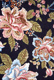 Ornate colorful floral tapestry on black Royalty Free Stock Photo