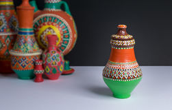 Ornate colorful pottery vase on background of blurred colorful vases Stock Image