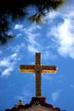 Ornate cross. With bright blue sky background Stock Photography