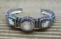 Ornate Cuff Bracelet. Ornate silver bracelet, with sparkling clear crystal mystic topaz stones Royalty Free Stock Photos