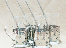 Ornate cups in a steel frame Royalty Free Stock Photography
