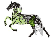 Ornate dark horse in a jump Stock Photo