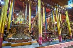 Ornate decoration of Nga Phe Chaung Monastery, Ywama, Inle Lake,. YWAMA, MYANMAR - FEBRUARY 18, 2018: The scenic interior of old wooden Nga Phe Chaung monastery Stock Image