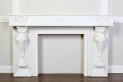 Ornate decorative plaster moldings in studio. Beautiful ornate white decorative plaster moldings in studio; horizontal view Royalty Free Stock Photos