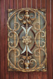 Ornate decorative wrought iron elements on the wood door Stock Images