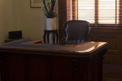 Ornate desk and chair. Ornate antique office desk and chair Stock Image