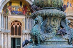 Lion of Saint Marc on a light fixture in front of Saint Mark`s B Royalty Free Stock Image