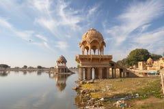 Ornate, Domed Jain Temple on Gadisar Lake, Jaisalmer, India. Ornate, intricately carved dome structures of Gadi Sagar Temple, on Gadisar Lake in Jaisalmer Stock Photo