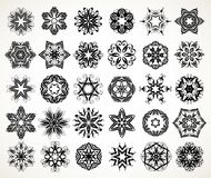 Ornate doodle mandalas. Set of ornate lacy doodle floral round rosettes in black over white backgrounds. Mandalas formed with hand drawn calligraphic elements Stock Photography