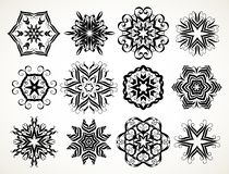 Ornate doodle mandalas. Set of ornate lacy doodle floral round rosettes in black over white backgrounds. Mandalas formed with hand drawn calligraphic elements vector illustration