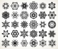 Ornate doodle mandalas. Set of ornate lacy doodle floral round rosettes in black over white backgrounds. Mandalas formed with hand drawn calligraphic elements royalty free illustration