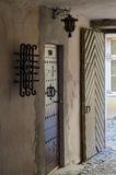 Ornate door and lantern in passageway Stock Photos