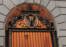 Ornate door in New York. Ornate entrance on wall street new york royalty free stock photography