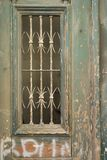 Ornate door with peeling paint and graffiti. Royalty Free Stock Photo