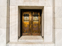 Ornate doors. Ornate brass and copper doors with bars on the windows Royalty Free Stock Photos