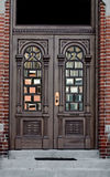 Ornate doorway in Brick Wall. Ornate antique doors with windows in brick wall Stock Photos