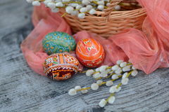 Ornate easter eggs near willow. On grey background Royalty Free Stock Image