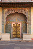 Ornate entrance doors at the city palace, Jaipur, India. Stock Photos