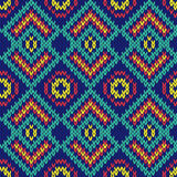 Ornate ethnic knitting motley seamless pattern mainly in blue hu Stock Images