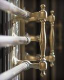 Brass Handles. Ornate exterior brass handles stock photography