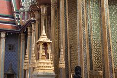 Ornate exterior details with columns and statues. Ornate exterior details of Wat Phra Kaew temple with columns and statues within Grand Palace complex in Bangkok royalty free stock photos