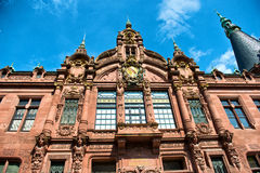 Ornate Facade of Heidelberg University Library. Low Angle View of Heidelberg University Library, Ornately Decorated Facade Above Entrance Against Blue Sky royalty free stock photos