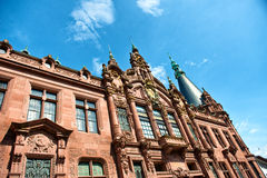 Ornate Facade of Heidelberg University Library. Low Angle View of Heidelberg University Library, Ornately Decorated Facade Above Entrance Against Blue Sky royalty free stock images