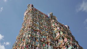 Ornate facade of Hindu temple. In low angle stock video