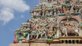 Ornate facade of Hindu temple. In low angle stock video footage
