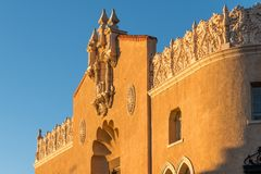 Ornate facade and rooftop of an historic Spanish renaissance style building in Santa Fe, New Mexico. Ornate facade and rooftop of an old adobe building glowing royalty free stock photography