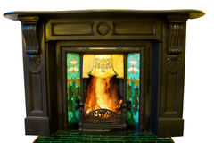 Ornate fireplace. With roaring fire isolated on white royalty free stock photography
