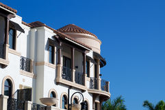 Ornate florida architecture. Looking up at balconies and a round room on the outside of an ornate building in tropical florida Stock Image