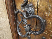 Ornate Foor Handle. An old cast Iron door candle stock image