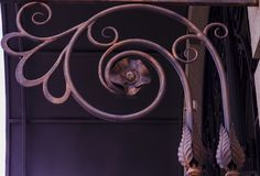 Ornate forged elements of a canopy above the door royalty free stock photo