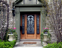 Ornate front door with flowers Stock Photos