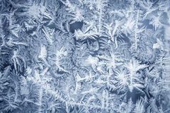 Ornate frost pattern on frosted window as Christmas background Stock Photography