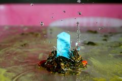 Colorful signpost with water drops. Ornate frozen water drops as background images Stock Photos