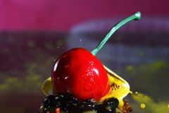 Delicious cherry with water drops. Ornate frozen water drops as background images Stock Photos