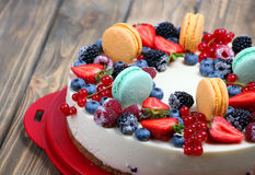 Ornate fruits and macaroon cheesecake Royalty Free Stock Images
