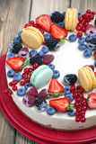 Ornate fruits and macaroon cheesecake Royalty Free Stock Photo